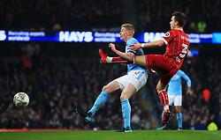 Joe Bryan of Bristol City tackles Kevin De Bruyne of Manchester City - Mandatory by-line: Matt McNulty/JMP - 09/01/2018 - FOOTBALL - Etihad Stadium - Manchester, England - Manchester City v Bristol City - Carabao Cup Semi-Final First Leg