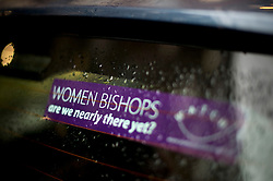 © London News Pictures. 20/11/2012. London, UK . A sticker in a car window at the entrance to  Church House in Westminster, London on day two of the three-day Church of England General Synod. Members will vote on whether to allow women to become bishops, 20 years after the Church decided to ordain women as priests. Photo credit: Ben Cawthra/LNP