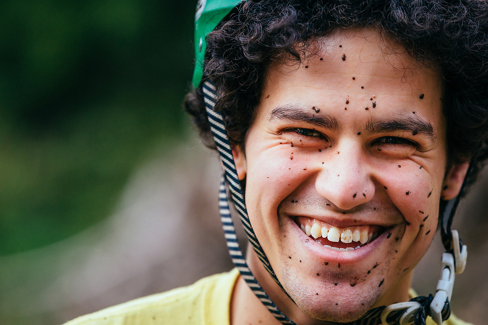 Zaid Elgawarsha looks into the camera while resting while covered in mud from riding in Bellingham, Washington.