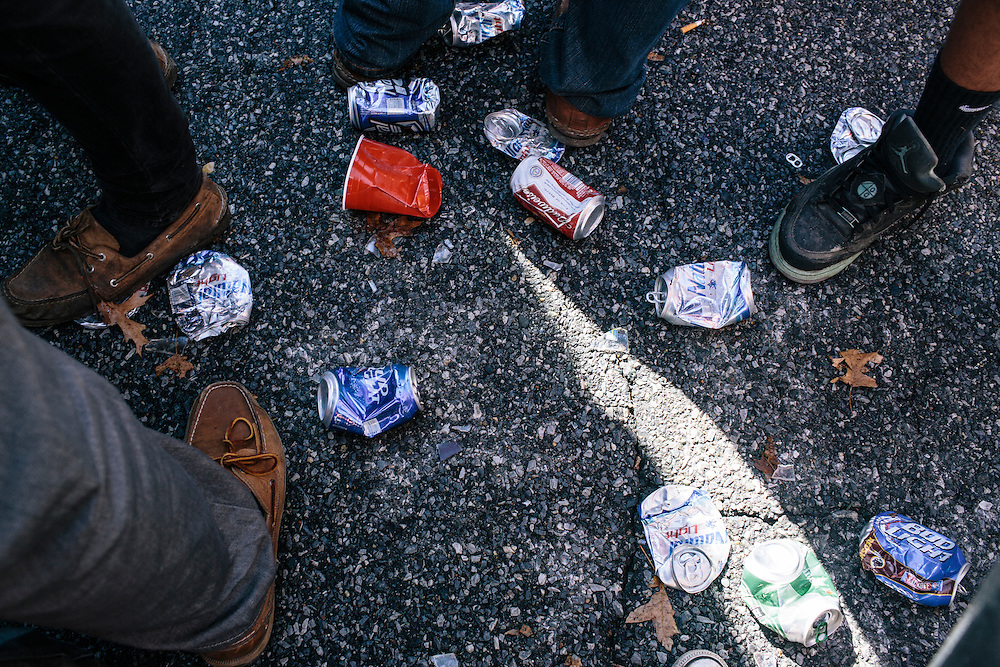 Beer cans litter the ground in the main parking lot outside of Capital One Field at Byrd Stadium during homecoming weekend on Oct. 18, 2014.