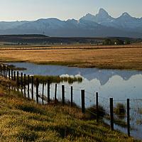 USA, Idaho. Grand Tetons View reflected in lake along Teton Scenic Byway.