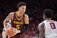 FAYETTEVILLE, AR - DECEMBER 9:  Amir Coffey #5 of the Minnesota Golden Gophers looks to drive against Jaylen Barford #0 of the Arkansas Razorbacks at Bud Walton Arena on December 9, 2017 in Fayetteville, Arkansas.  The Razorbacks defeated the Golden Gophers 95-79.  (Photo by Wesley Hitt/Getty Images) *** Local Caption *** Amir Coffey; Jaylen Barford