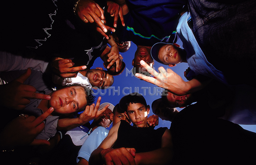 Group of kids giving the finger, two fingers up