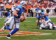 MORNING JOURNAL/DAVID RICHARD.Detroit quarterback Jeff Garcia, front left, scrambles in the end zone while Browns' defensive lineman Ethan Kelley, lower right, watches with Lions' center Dominic Raiola on top of him yesterday. Holding was not called.