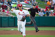 Third Base Umpire Matthew Czajak runs to his position during a play in a game between the Northwest Arkansas Naturals and Springfield Cardinals at Hammons Field on August 23, 2013 in Springfield, Missouri. (David Welker)