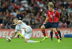 Norway's Ruben Jenssen fouls England's Jack Wilshere (Arsenal) - Photo mandatory by-line: Alex James/JMP - Mobile: 07966 386802 - 3/09/14 - SPORT - FOOTBALL - London - Wembley Stadium - England v Norway - International Friendly