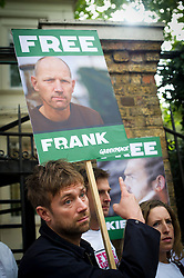 © London News Pictures. 05/10/2013.  London, UK. Musician Damon Albarn holding a placard showing the face of Frank Hewetson a Greenpeace activist at the demo.  Supporters of Greenpeace stage a demonstration outside the Russian Embassy in London to protest against the arrest of 30 Greenpeace activists, known as the 'Arctic 30' who charged with piracy by a Russian court, following a peaceful protest against Arctic oil drilling at an oil platform in the Pechora Sea. Photo credit Ben Cawthra/LNP