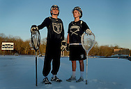 04/05/16 - Cohasset, MA - Cohasset High School lacrosse goalies Conor Naughton (cq), senior, left, and Mason Fitzgerald (cq), freshman, right, pose for a portrait outside the school in Cohasset, MA, on April 5, 2016.