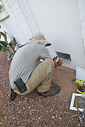 Jesse Micander installs screen on lower opening of my furnace room door.