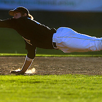Bend Elks' third baseman Jo Carroll (16) dives to make the play on a line drive during the fourth inning Tuesday evening against the Thurston County Senators at Vince Genna Stadium.