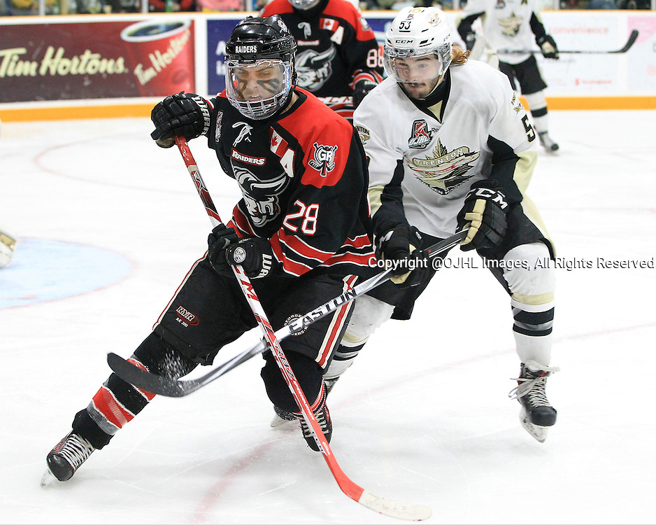 TRENTON, ON - Apr 18, 2016 -  Ontario Junior Hockey League game action between Trenton Golden Hawks and the Georgetown Raiders. Game 3 of the Buckland Cup Championship Series  at the Duncan Memorial Gardens in Trenton, Ontario. Josh Dickinson #28 of the Georgetown Raiders and Josh Allan #53 of the Trenton Golden Hawks skates after the puck during the third period.<br /> (Photo by Tim Bates / OJHL Images)