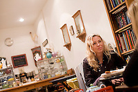 5 November, 2008. New York, NY. Customers have tea and relax at the Podunk, a self-styled &quot;American tearoom&quot; in the East Village.The owner, Elspeth Treadwell, left a career in publishing to open Podunk six years ago, in 2002. <br /> <br /> &copy;2008 Gianni Cipriano for The New York Times<br /> cell. +1 646 465 2168 (USA)<br /> cell. +1 328 567 7923 (Italy)<br /> gianni@giannicipriano.com<br /> www.giannicipriano.com