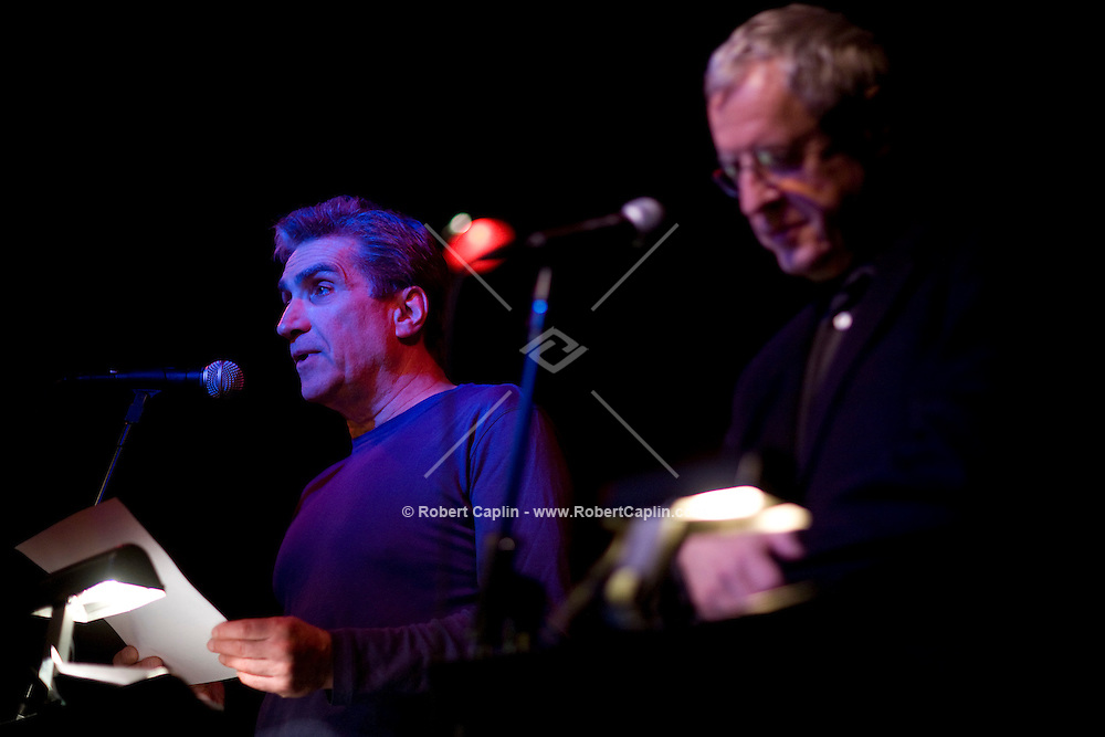 Current US poet laureate Charles Simic, right, and former laureate, Robert Pinsky, left, read some poetry during a collaboration with jazz musicians at the Jazz Standard in New York, U.S. 1/8/08.