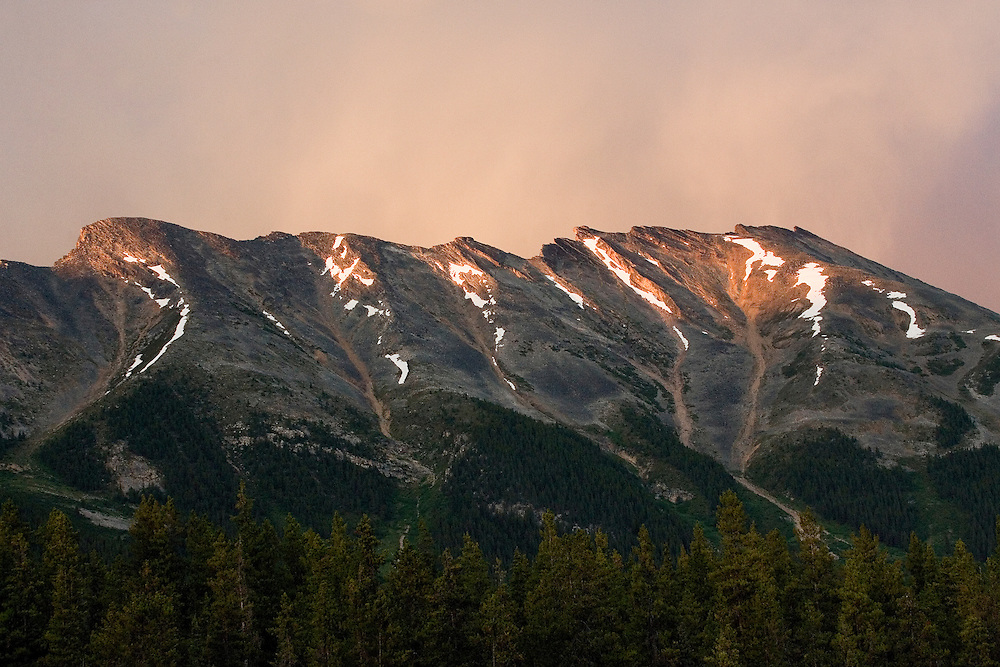 Sunset after rain over the Endless Chain mountain range in Alberta's Jasper National Park.