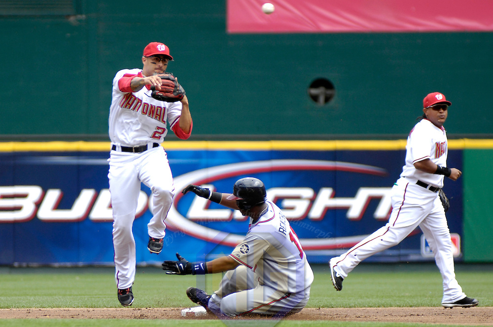 17 May 2006:  Atlanta Braves shortstop Edgar Renteria (11) is out at second base as Washington Nationals shortstop Felipe Lopez (2) completes a double play in the 1st inning on ball hit by Atlanta Braves third baseman Chipper Jones. The Nationals defeated the Braves 4-3 at RFK Stadium in Washington, D.C.