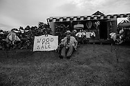"""Al Bush, who travels from location to location via motorhome with his wife and pets sits for a portrait on land he occupies with permission from a friend during the annual """"50 Mile Yardsale"""", Saturday, July 20, 2016 along Route 90 in the Cayuga Lake region of the Finger Lakes, New York."""