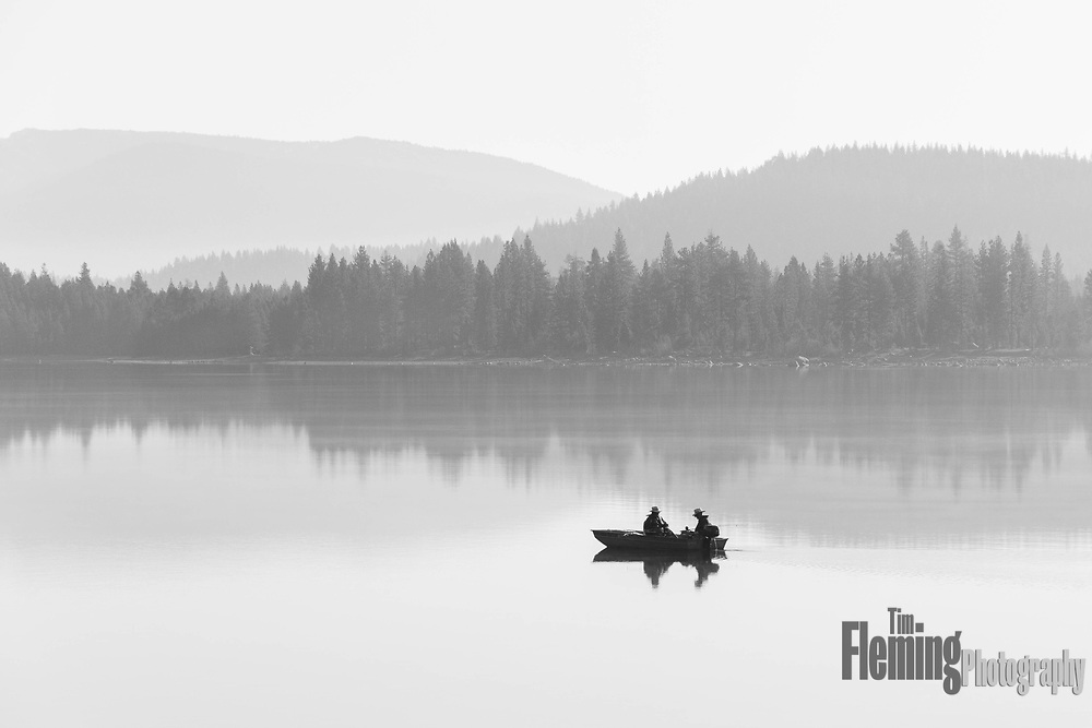 Two men in a fishing boat on Donner Lake, in the Sierra mountains of California.