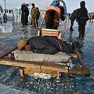 Mongolia. Ice festival on the frozen Khuvsgul lake. - siberia border - for the mongol new year ,  tsagaan sar, in the cold winter   Khuvsgul province -   /  Festival des glaces sur le lac gelé de Khovsgol - frontiere siberienne-  pour Tsagan sar; le nouvel an mongol, en hivoir dans le froid   Khovgul  - Mongolie /  L0055880