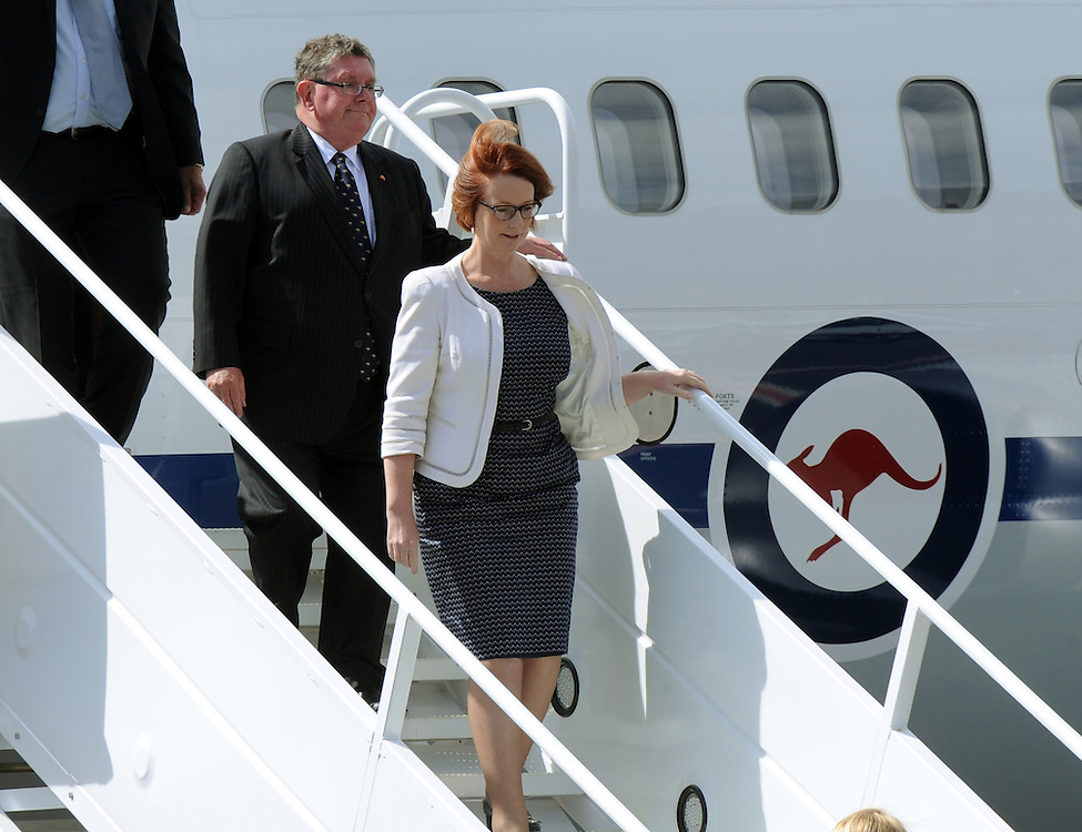 Australian Prime Minister Julia Gillard disembarks from her plane followed by the Australian High Commissioner to New Zealand Michael Potts at Queenstown Airport, for bilateral talks with the New Zealand Government, Queenstown, New Zealand, Friday, February 08, 2013. Credit:SNPA / Ross Setford