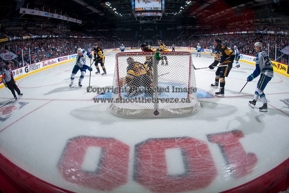 REGINA, SK - MAY 21: Beck Malenstyn #19 of Swift Current Broncos takes a shot on Kaden Fulcher #33 of Hamilton Bulldogs at the Brandt Centre on May 21, 2018 in Regina, Canada. (Photo by Marissa Baecker/CHL Images)