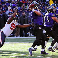 15 January 2012: Baltimore Ravens quarterback Joe Flacco (5) in action against Houston Texans defensive end Tim Jamison (96) in the Divisional Playoff at M&T Bank Stadium in Baltimore, MD. The Ravens defeated the Texans 20-13 to advance to the AFC Championship game..