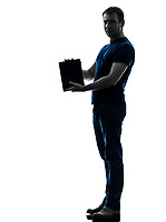 one  man holding showing digital tablet in silhouette on white background