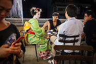 Fukunae,'maiko' (geisha apprentice)working  in a tea house.Geisha's distric of Gion.Kyoto. Kansai, Japan.