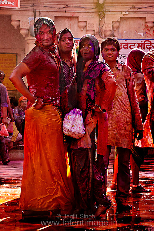 Everybody is drenched with wet color. A group striking pose for the photograph. Braj ki Holi