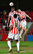 Matt Taylor and Mathieu Manset clear the ball during the Sky Bet League 2 match between Cheltenham Town and Cambridge United at Whaddon Road, Cheltenham, England on 14 April 2015. Photo by Alan Franklin.