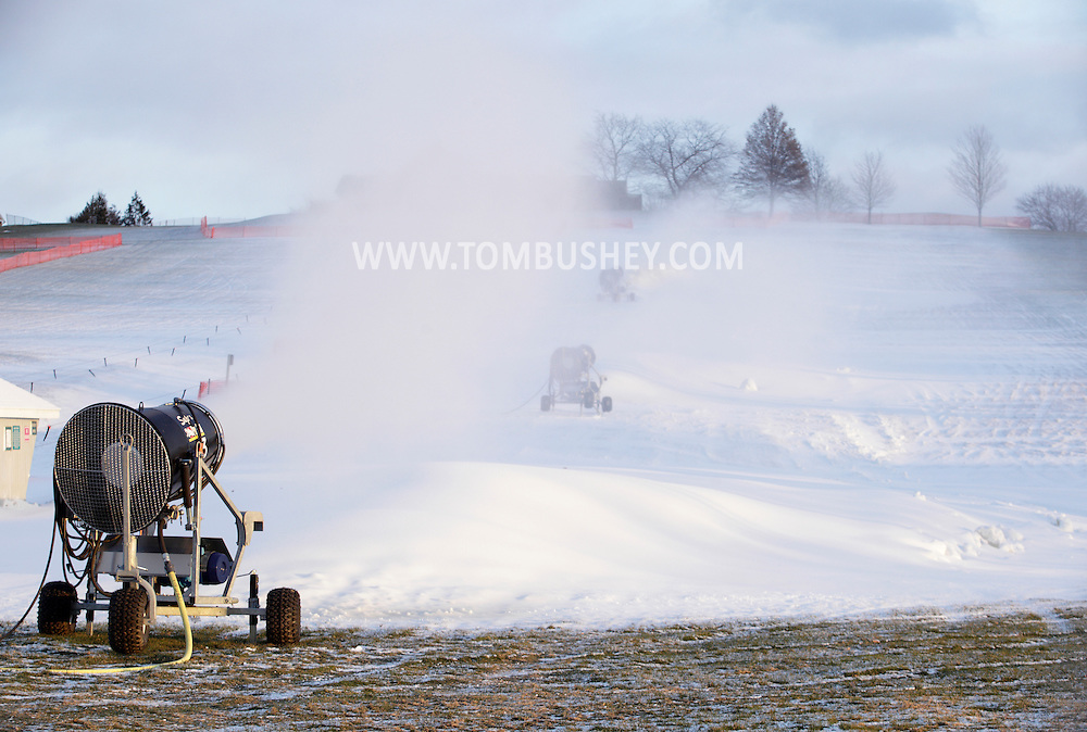 Hamptonburgh, New York - Snow-making machines blow snow onto the snow-tubing hill at Thomas Bull Memorial Park on  Dec. 14, 2010.