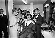 17/07/1967<br /> 07/17/1967<br /> 17 July 1967<br /> Opening of new men's salon at Brown Thomas, Grafton Street, Dublin. Brendan O'Reilly, the TV personality opened a new Mens Department in Brown Thomas and Co. Ltd.. In the new department was a hairdressing salon where while getting your hair done it was possible to make phone calls from the chair. Image shows Fraulein Margaret Mende and Fraulein Brigitte Huhn (on left) of H. Horten GMBH, Germany, who were working in Brown Thomas and Co. Ltd. for a short period, who think they can improve Brendan O'really's hairstyle as Tony Byrne looks on.