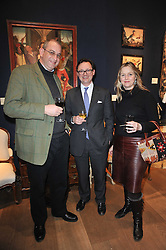Left to right, WILLIE STIRLING, VISCOUNT DUNLUCE and CHARLOTTE STIRLING at a party to celebrate the publication of The irish Country House written by The Knight of Glin and James Peill with photographs by James Fennell, held at Christie's, King Street, London on 24th January 2011.