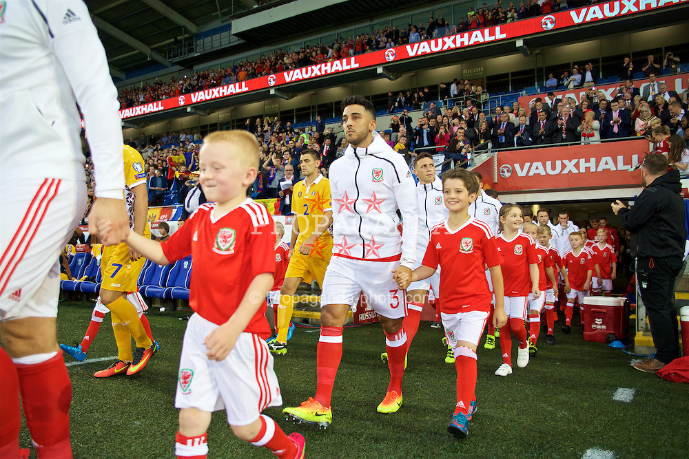 CARDIFF, WALES - Monday, September 5, 2016: Wales' Neil Taylor walks out to face Moldova before the 2018 FIFA World Cup Qualifying Group D match at the Cardiff City Stadium. (Pic by David Rawcliffe/Propaganda)