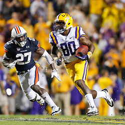 Sep 21, 2013; Baton Rouge, LA, USA; LSU Tigers wide receiver Jarvis Landry (80) runs from Auburn Tigers defensive back Robenson Therezie (27) during the second half of a game at Tiger Stadium. LSU defeated Auburn 35-21. Mandatory Credit: Derick E. Hingle-USA TODAY Sports