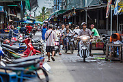 29 JULY 2014 - HAT YAI, SONGKHLA, THAILAND: People on motorcycles in the market in Hat Yai. Hat Yai is the 4th largest city in Thailand and the largest outside of the Bangkok metropolitan area. It's less the 50 miles from the Malaysian border and is a popular vacation spot for Malaysian and Singaporean tourists.       PHOTO BY JACK KURTZ