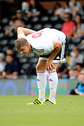 Fulham striker, Matt Smith (09) touching his back during the Pre-Season Friendly match between Fulham and Crystal Palace at Craven Cottage, London, England on 30 July 2016. Photo by Matthew Redman.