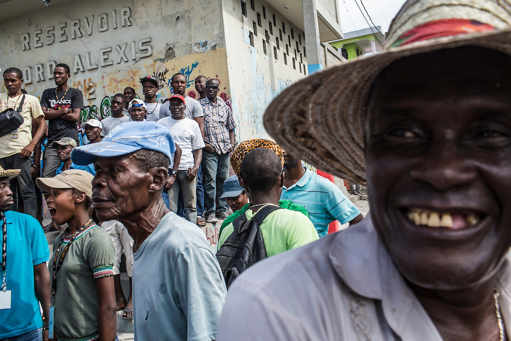 Anti-government protesters gather on Tuesday, December 16, 2014 in Port-au-Prince, Haiti. President Michel Martelly was elected in 2010 with great hope for reforms, but in the wake of slow recovery and parliamentary elections that are three years overdue, his popularity has suffered tremendously, forcing Prime Minister Laurent Lamothe to resign.