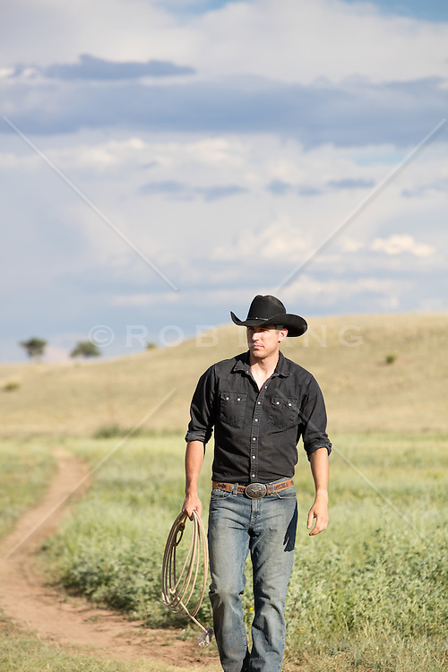 chiseled cowboy on a beautiful ranch