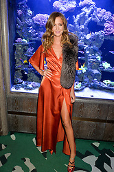 MILLIE MACKINTOSH at a dinner hosted by Creme de la Mer to celebrate the launch of Genaissance de la Mer The Serum Essence held at Sexy Fish, Berkeley Square, London on 21st January 2016.