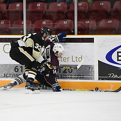 TRENTON, ON  - MAY 4,  2017: Canadian Junior Hockey League, Central Canadian Jr. &quot;A&quot; Championship. The Dudley Hewitt Cup. Game 6 between Trenton Golden Hawks and the Dryden GM Ice Dogs. James Thomson #33 of the Trenton Golden Hawks tries to keep the puck from  Eric Stout #14 of the Dryden GM Ice Dogs during the first period.<br /> (Photo by Andy Corneau / OJHL Images)