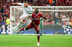 Sergio Ramos of Real Madrid vs Sadio Mané of Liverpool during the UEFA Champions League final football match between Liverpool and Real Madrid at the Olympic Stadium in Kiev, Ukraine on May 26, 2018.Photo by Sandi Fiser / Sportida
