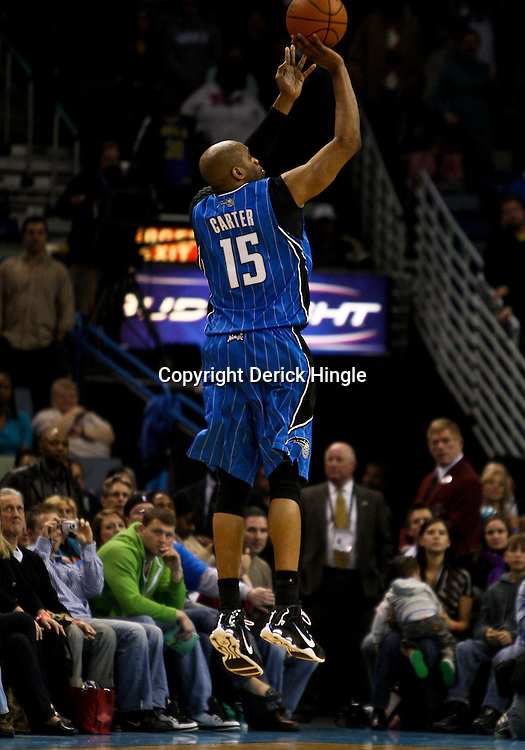 Feb 26, 2010; New Orleans, LA, USA; Orlando Magic guard Vince Carter (15) shoots against the New Orleans Hornets during the second half at the New Orleans Arena. The Hornets defeated the Magic 100-93. Mandatory Credit: Derick E. Hingle-US PRESSWIRE