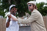 """Spike Lee on location filming a new movie in New Orleans with Brad Pitt on the deck in one of the homes at the """"Make it Right""""  housing project."""