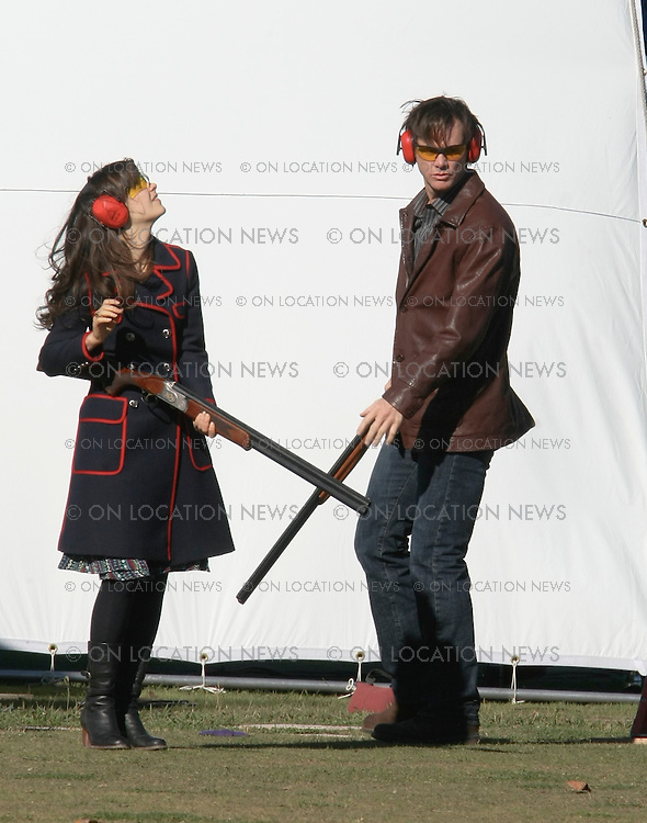 """Los Angeles, CA.December 04, 2007 EXCLUSIVE Photo. Jim Carey and Zooey Deschanel film a competitive skeet shooting scene for """"Yes Man"""". In between takes Jim Carey and Zooey Deschanel share an extended hug. Jim Carey seemed nervous when the gun handler was showing Zooey Deschanel the correct shooting technique. Photo By Ford/ Buchan/ On Location News. 818-613-3955 info@onlocationnews.com"""