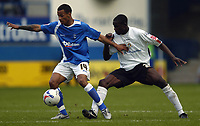 Photo: Jonathan Butler.<br />Luton Town v Birmingham City. Coca Cola Championship. 14/10/2006.<br />Leon Barnett of Luton tries to tackle Dudley Campbell of Birmingham.