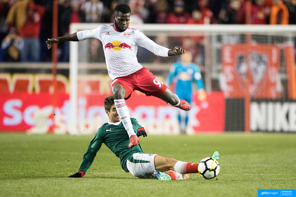 HARRISON, NEW JERSEY- APRIL 10:  Kemar Lawrence #92 of New York Red Bulls is challenged by Isaac Brizuela #11 of  C.D. Guadalajara during the New York Red Bulls Vs C.D. Guadalajara CONCACAF Champions League Semi-final 2nd leg match at Red Bull Arena on April 10, 2018 in Harrison, New Jersey. (Photo by Tim Clayton/Corbis via Getty Images)