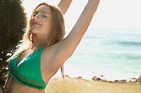 Young woman in bikini at beach half length
