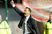 Derby County manager Darren Wassall punches the air after his teams 3-2 win over Bristol City during the Sky Bet Championship match between Bristol City and Derby County at Ashton Gate, Bristol, England on 19 April 2016. Photo by Graham Hunt.