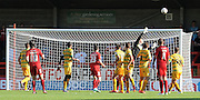 Luke Rooney puts a freekick over during the Sky Bet League 2 match between Crawley Town and Yeovil Town at the Checkatrade.com Stadium, Crawley, England on 19 September 2015. Photo by Michael Hulf.