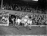 19/10/1955<br /> 10/19/1955<br /> 19 October 1955<br /> Soccer International: Ireland v Yugoslavia at Dalymount Park, Dublin. Peter Farrell (right) leads out the Irish team.